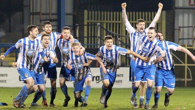 Coleraine players celebrate a penalty shootout victory over Ballinamallard