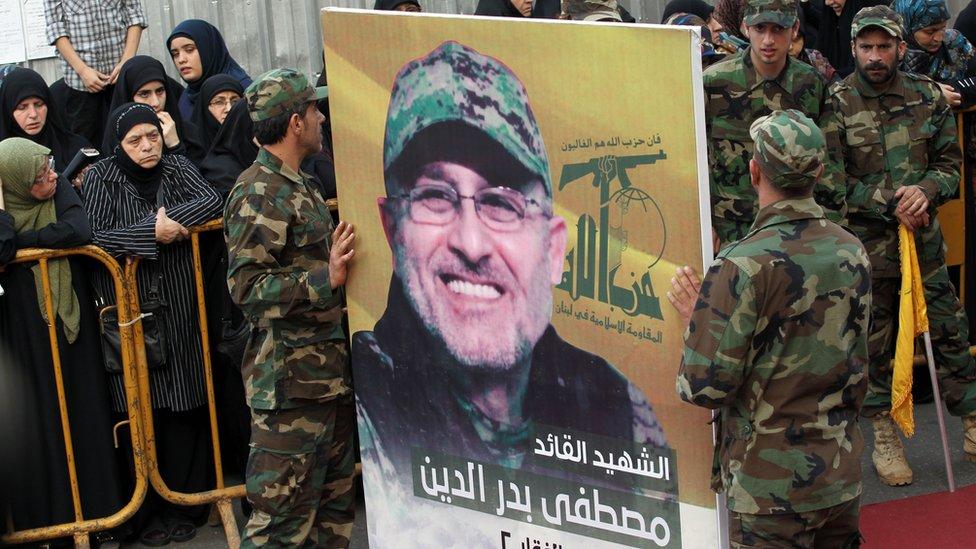 Members of Hezbollah carry a portrait of Mustafa Badreddine at his funeral in Ghobeiry, Beirut (13 May 2016)