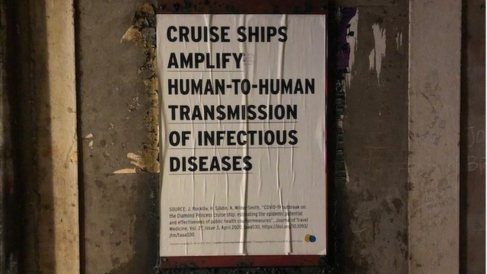 "Poster stuck to a wall saying ""cruise ships amplify transmission of infectious diseases"""