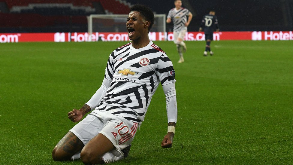 Marcus Rashford celebrates his match-winning goal against PSG in the UEFA Champions League on 21 October