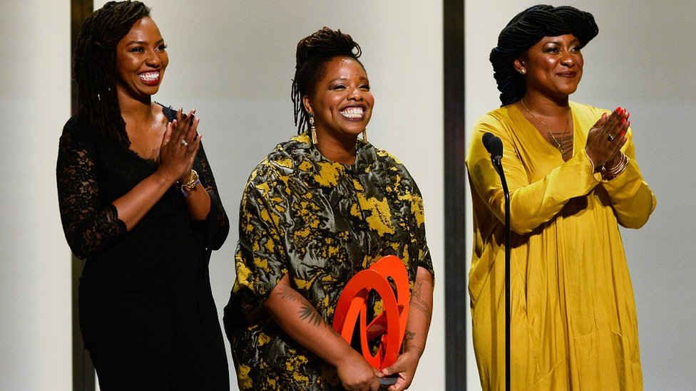 Opal Tometi, Patrisse Cullors, and Alicia Garza accept an award onstage during Glamour Women Of The Year 2016 at NeueHouse Hollywood on 14 November 2016 in Los Angeles, California