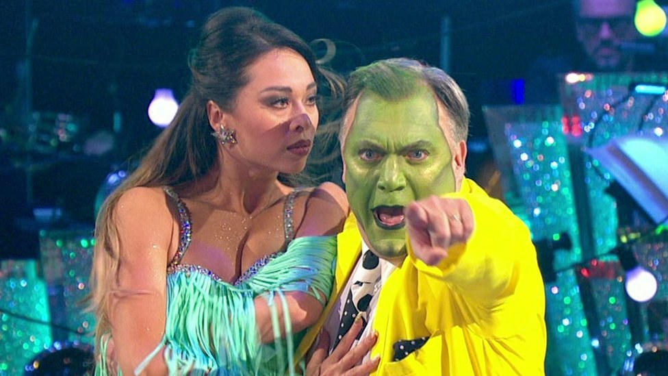 Ed Balls performing as The Mask