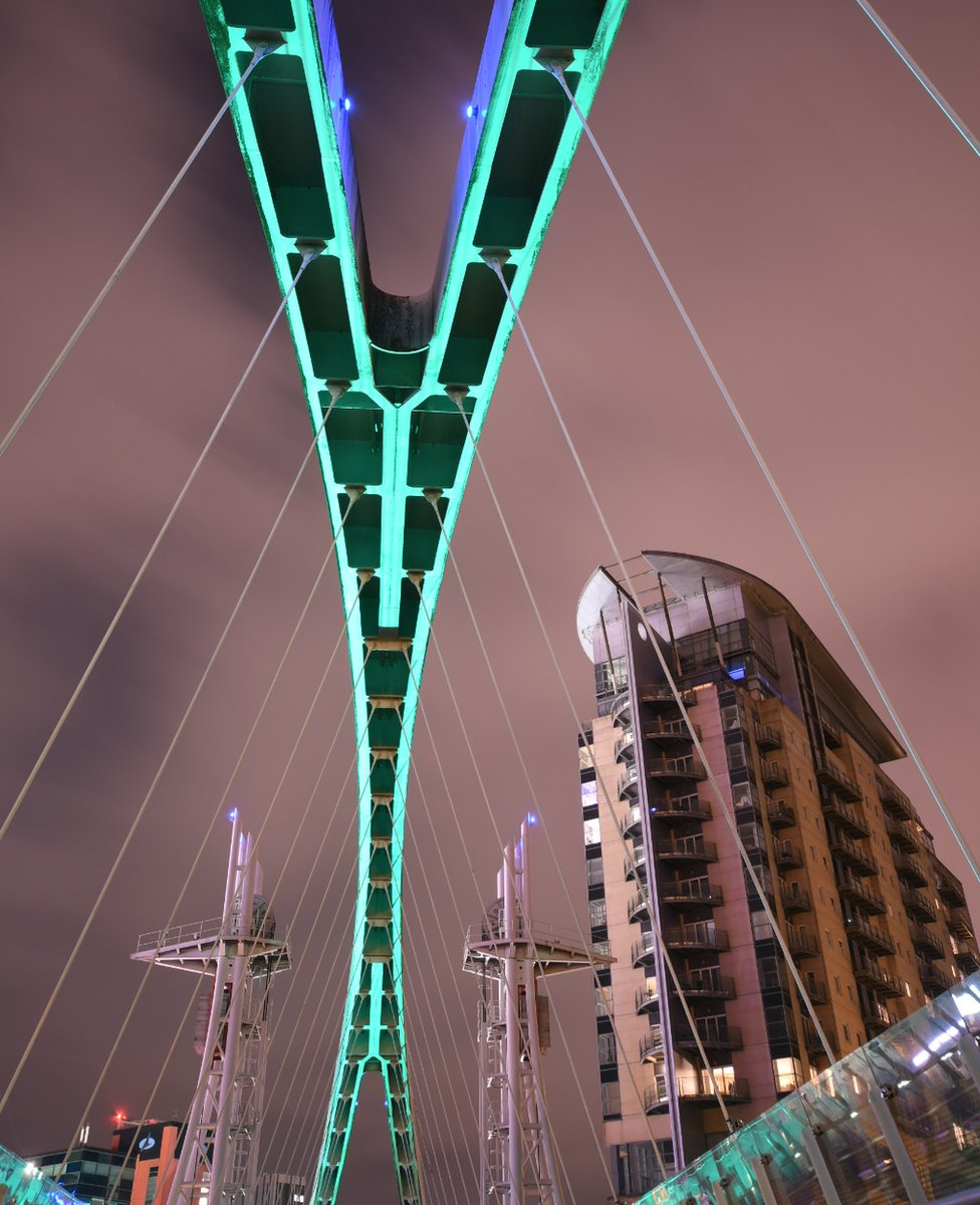 Bridge lit over water