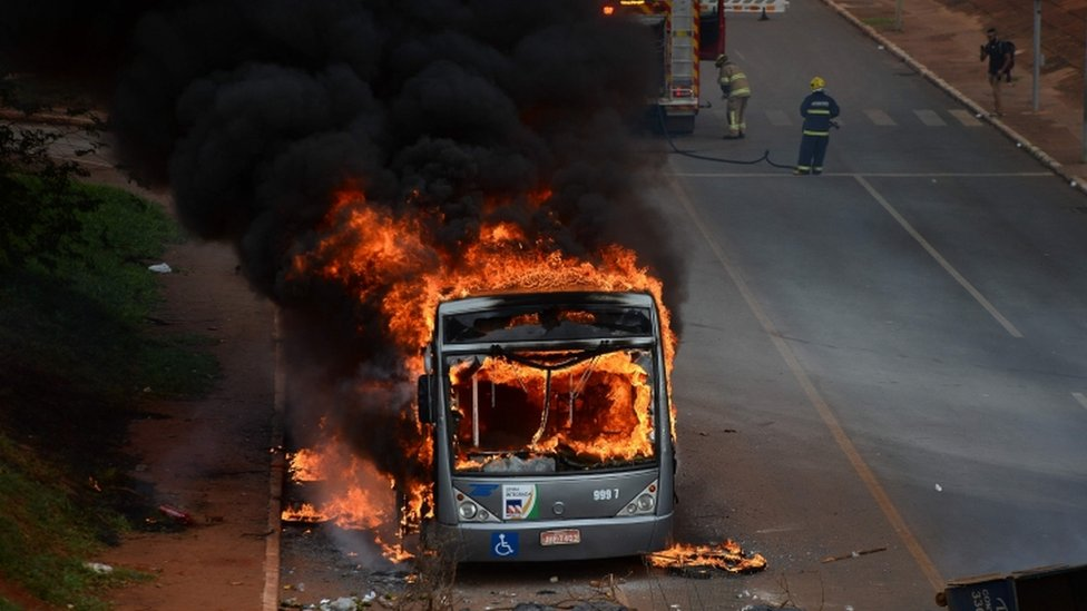Students set buses on fire during a protest in front of the National Congress in Brasilia