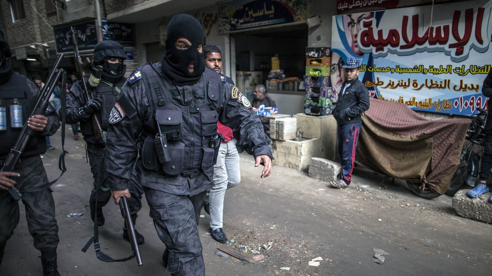Members of Egyptian police special forces patrol streets in al-Haram district of Cairo on 25 January 2016