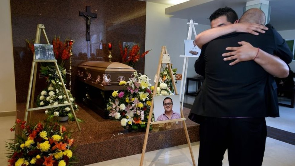 Relatives of Mexican journalist Hector Gonzalez Antonio, who was found beaten to death in Tamaulipas state, hug during his wake in Mexico City. Photo: 31 May 2018