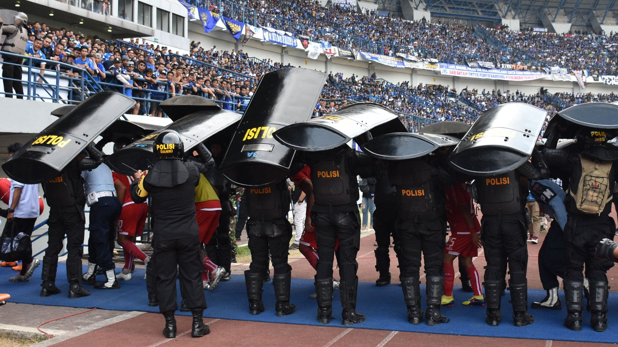Indonesia suspends top-flight football after fan dies at match