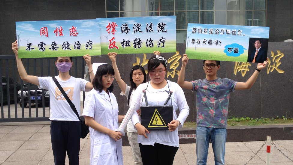 Gay activists stage a small protest outside courtroom on Thursday (7/31/14) where a gay man sued counselors for trying to 'cure' him of homosexuality with electric shock treatments