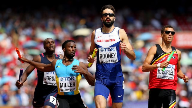Martyn Rooney runs the final relay leg for Great Britain