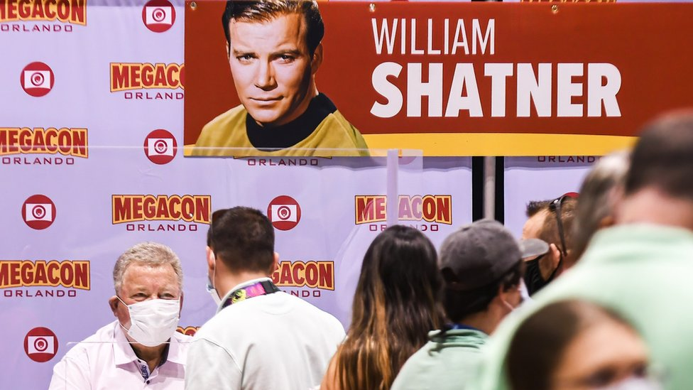 Actor William Shatner, best known for his portrayal of Captain James T. Kirk of the USS Enterprise in the Star Trek television series and movies, signs autographs for fans on the opening day of MEGACON at the Orange County Convention Center.