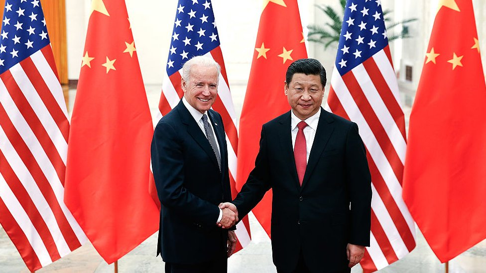 : Chinese President Xi Jinping (R) shake hands with U.S Vice President Joe Biden (L) inside the Great Hall of the People on December 4, 2013 in Beijing, China