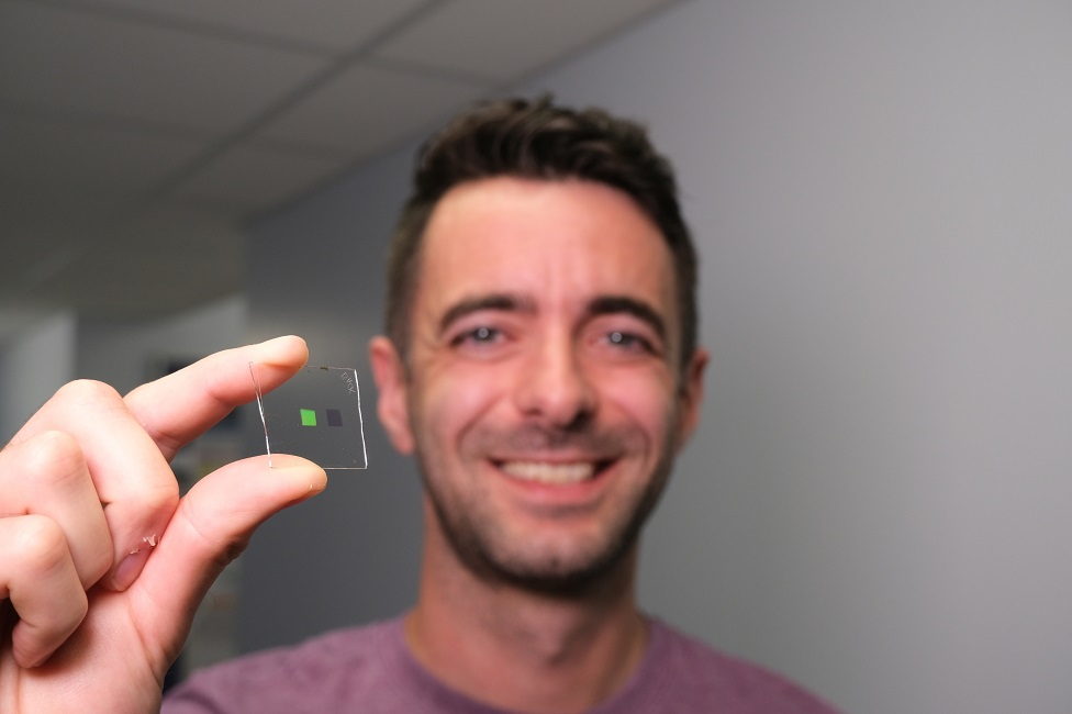 """Dr Alasdair Clark holding up a scaled-up version of the materials that make up the """"tongue"""""""