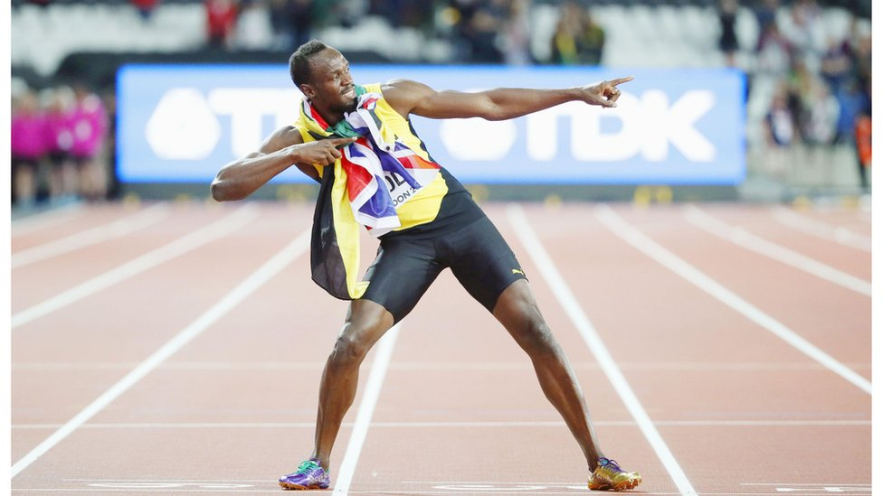 Usain Bolt of Jamaica poses after finishing third in the men's 100-meter final at the World Athletics Championships in London on Aug. 5, 2017