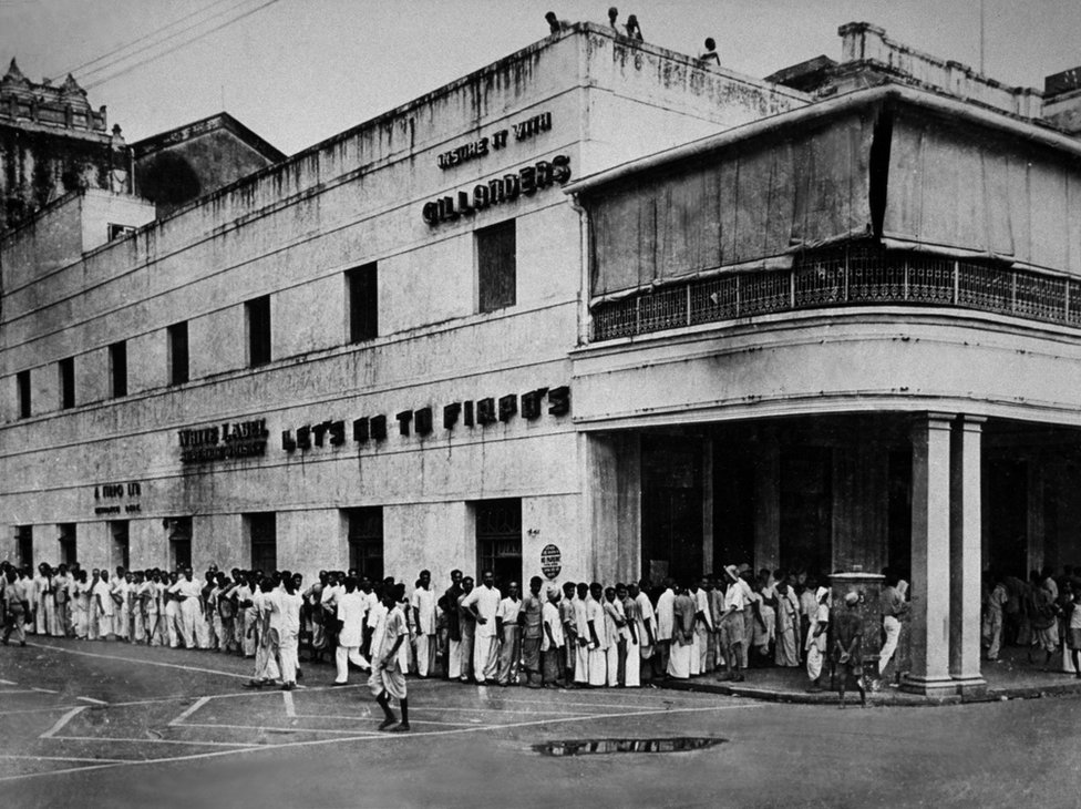1946: A food queue in Calcutta, after four days of rioting and looting.