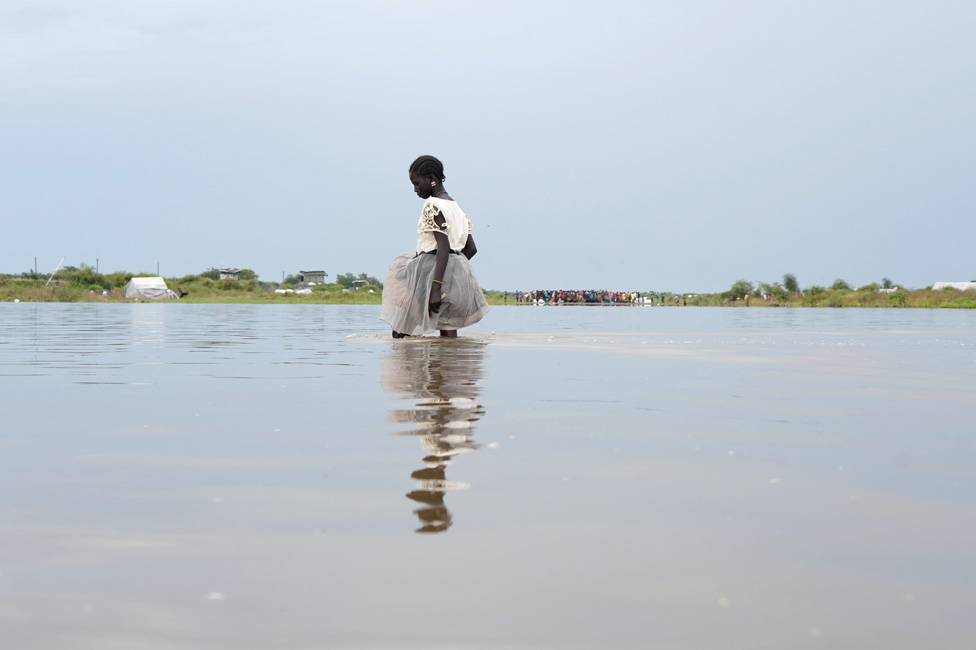 A girl walks in water after heavy rains and floods forced hundreds of thousands of people to leave their homes, in the town of Pibor, Boma state, South Sudan, November 6, 2019. Picture taken November 6, 2019