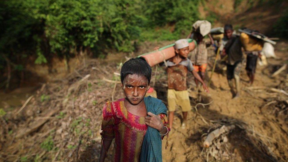 Rohingya Muslims, fled from ongoing military operations in Myanmars Rakhine state, walk towards Bangladesh
