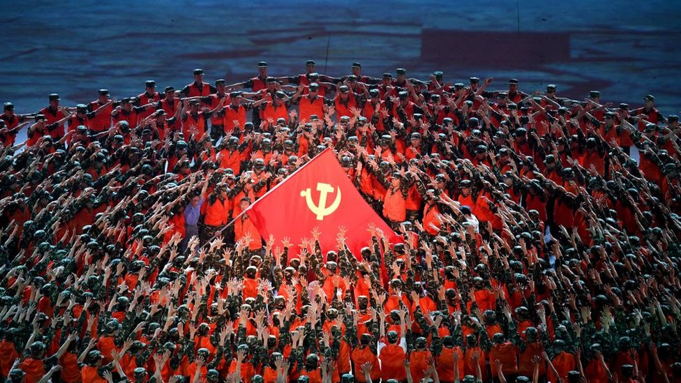 Performers dance during a Cultural Performance as part of the celebration of the 100th Anniversary of the Founding of the Communist Party of China, at the Bird's nest national stadium in Beijing on June 28, 2021