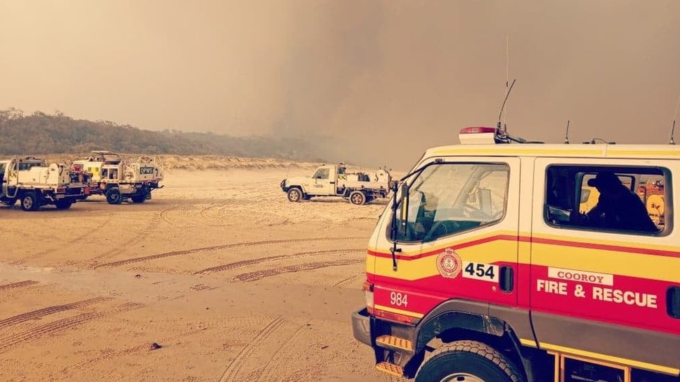 Fire trucks on the beaches at Fraser Island during the major bushfires in December 2020
