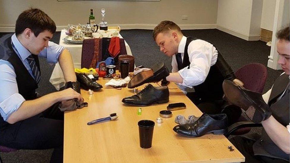 Trainee butlers shoe polishing