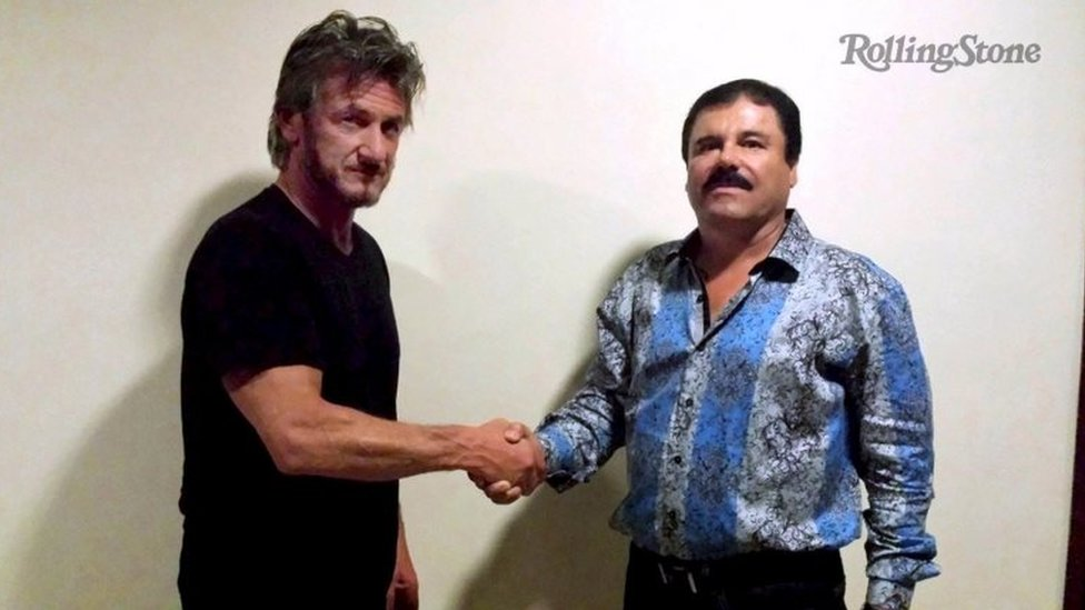 """Actor Sean Penn (left) shakes hands with Mexican drug lord Joaquin """"Chapo"""" Guzman in Mexico, in this undated Rolling Stone handout photo obtained by Reuters on 10 January, 2016."""