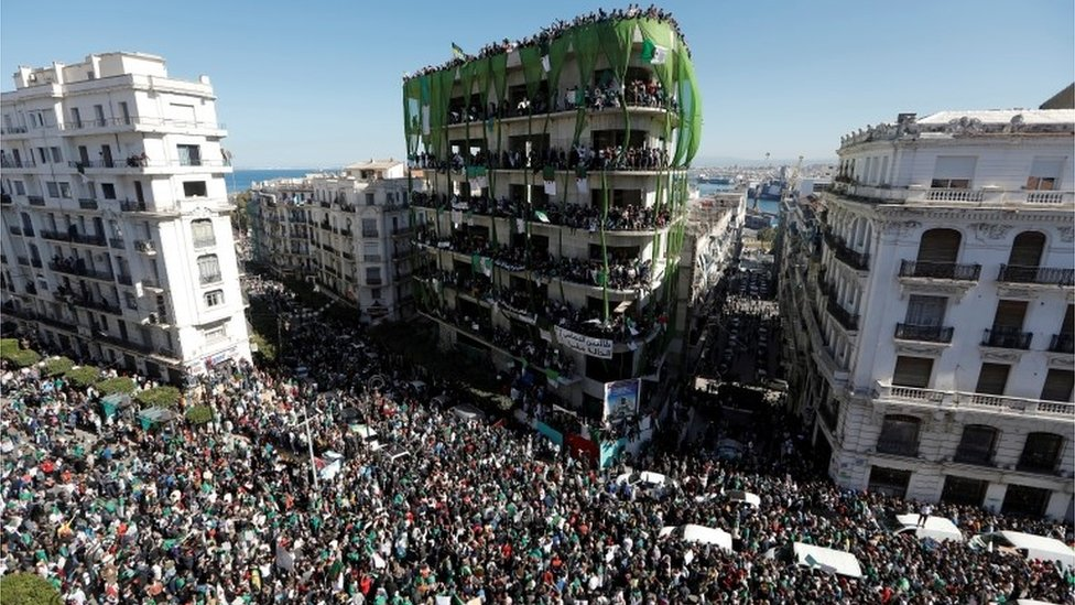 """People gather during a protest over President Abdelaziz Bouteflika""""s decision to postpone elections and extend his fourth term in office, in Algiers, Algeria March 15, 2019"""