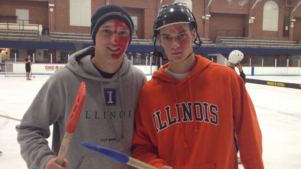 Marcin Kleczynski and a friend at college playing the sport of broomball