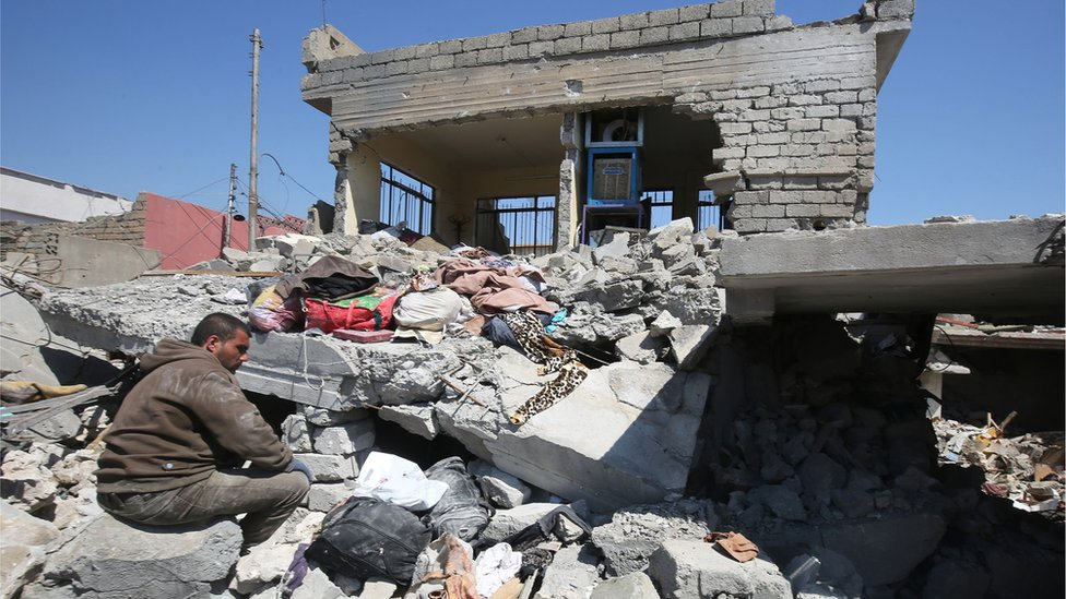 This file photo taken on March 26, 2017 shows an Iraqi man amid the rubble of destroyed houses in the Mosul al-Jadida area, following air strikes in which civilians have been reportedly killed during an ongoing offensive against the Islamic State (IS) group. U