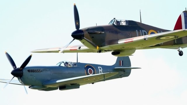 Vintage planes fly in formation as part of a Battle of Britain 75th Anniversary flypast at Goodwood Aerodrome