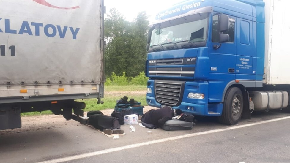 Jewish pilgrims rest between trucks near the Novi Yarylovychi crossing point