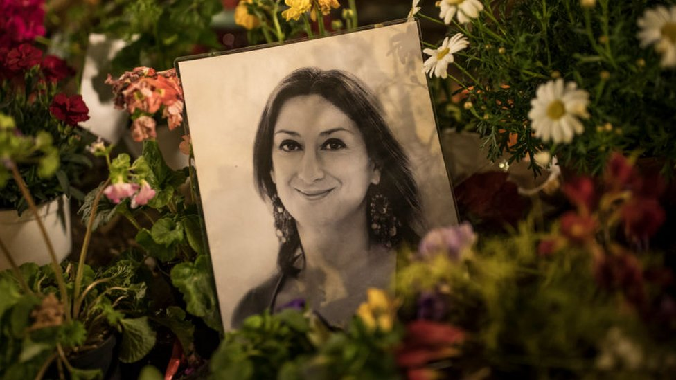 Flowers and tributes for Daphne Caruana Galizia left at a monument in Malta in March 2018
