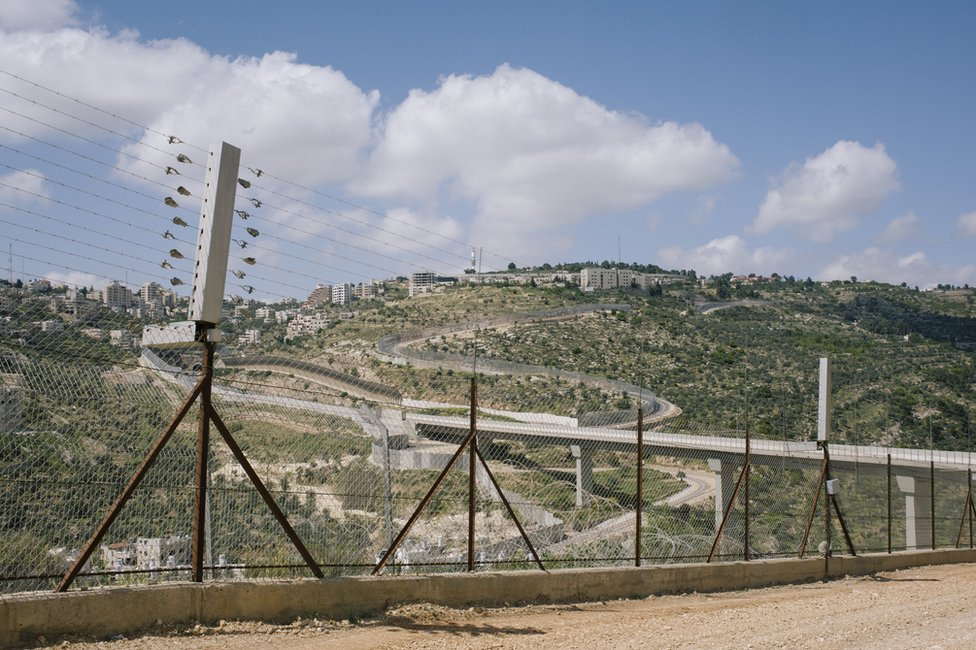 View of the Israeli/Palestinian barrier wall and Route 60 in Har Gillo, West Bank