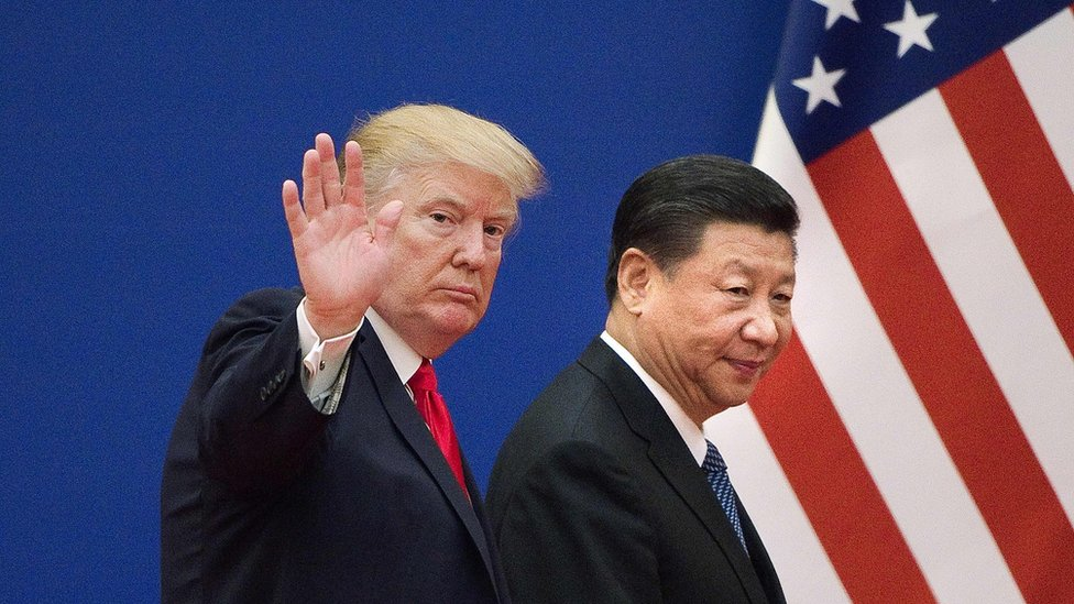 """This file picture taken on November 9, 2017 shows US President Donald Trump (L) and China""""s President Xi Jinping leaving a business leaders event at the Great Hall of the People in Beijing."""