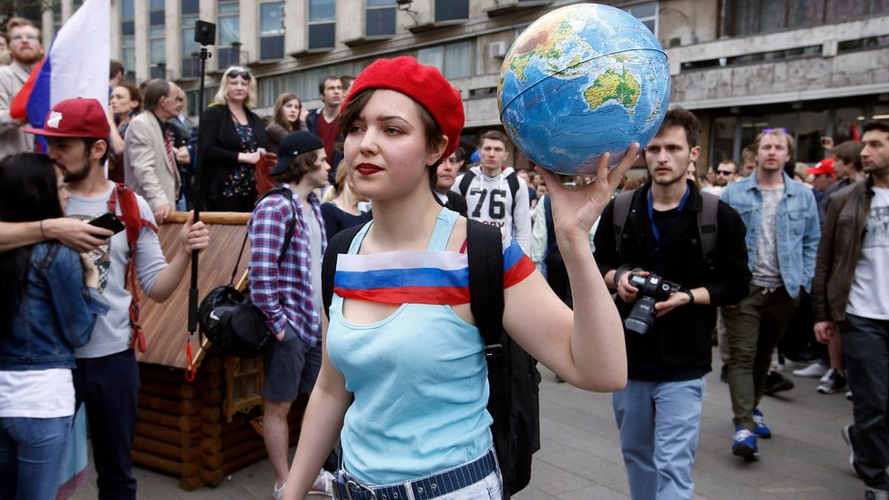 A girl with a globe in Tverskaya street in central Moscow, Russia, 12 June 2017, where opposition supporters hold an unauthorised rally