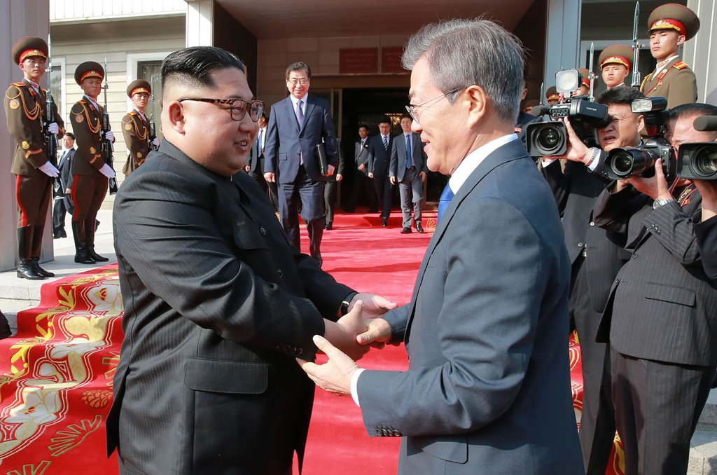 """This photograph taken on May 26, 2018 and released by North Korea""""s official Korean Central News Agency (KCNA) on May 27 shows South Korea""""s President Moon Jae-in (R) shaking hands with North Korea""""s leader Kim Jong Un after their second summit at the north side of the truce village of Panmunjom in the Demilitarized Zone (DMZ). Kim Jong Un believes a summit with US President Donald Trump will be a landmark opportunity to end decades of confrontation, South Korea""""s President Moon Jae-in said May 27 following his surprise meeting with the North Korean leader. / AFP PHOTO / KCNA VIA KNS /"""