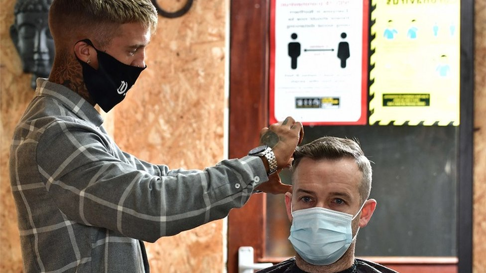 Barber Jay Irvine with Customer Pat Wall at Outlaw Barbering Company in Crumlin