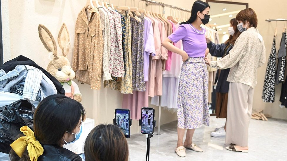 A clothing store in the southern city of Guangzhou sells clothing via live broadcast