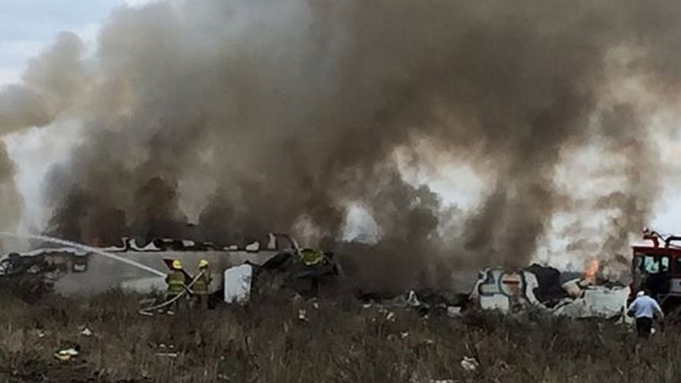 A handout photo made available by the Civil Protection State Coordination (CPCE) shows emergency personnel at the site where an Aeromexico plane crashed, in Durango, Mexico, 31 July 2018.