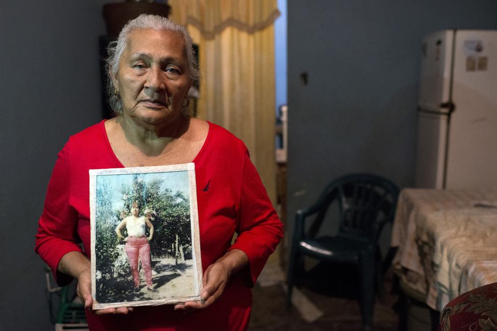 Edita Maldonado holds a picture of her late daughter Rosa