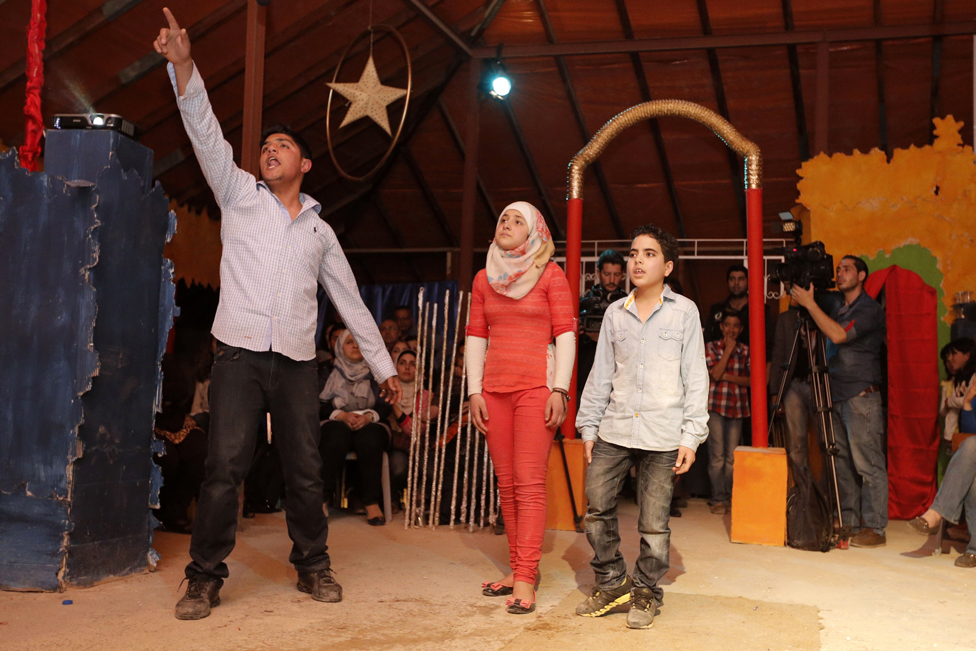 Syrian refugees perform in William Shakespeare's 'Romeo and Juliet', directed by acclaimed Syrian actor Nawar Bulbul, on March 27, 2015 on the rooftop of a makeshift hospital in the Jordanian capital, Amman.