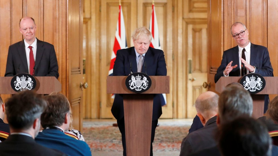 Boris Johnson gives a press conference with Chris Whitty, the chief medical officer, and Patrick Vallance, the chief scientific advisor, in Downing St