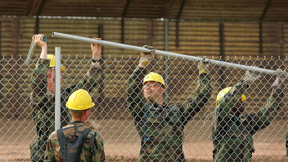 US Army Rangers erect a chain-link fence to further fortify the US/Mexico border