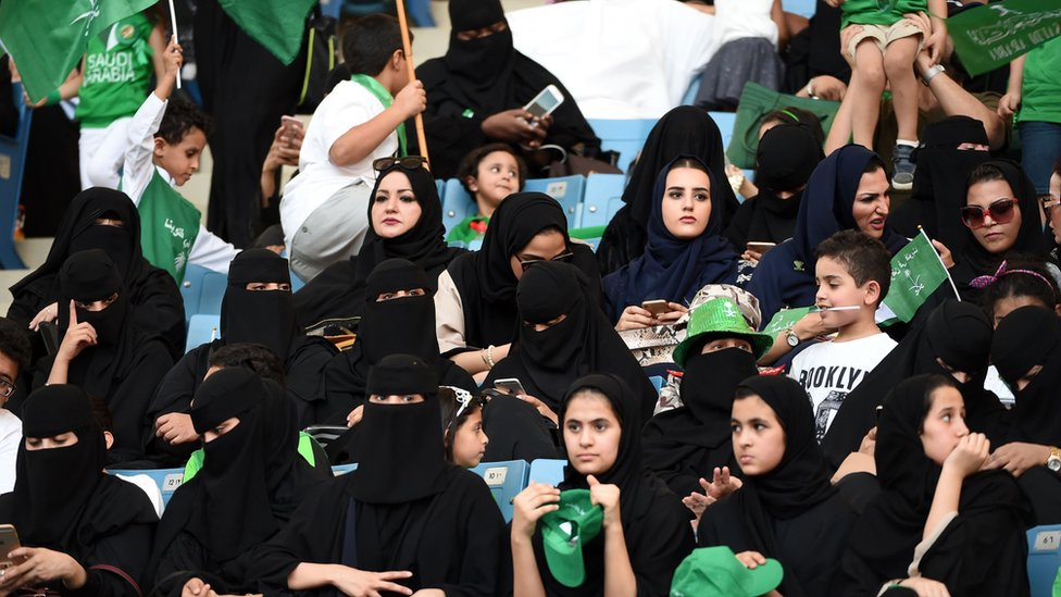 Saudi women sit in a stadium to attend an event in the capital Riyadh on 23 September 2017 commemorating the anniversary of the founding of the kingdom