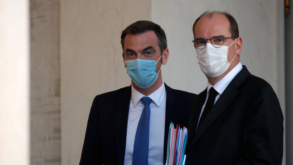 French Prime Minister Jean Castex and Health Minister Olivier Veran, wearing protective face masks, leave following the weekly cabinet meeting