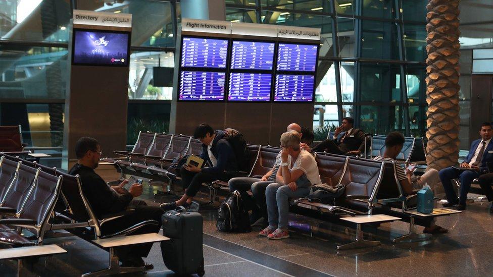 Passengers wait at Hamad International Airport in the Qatari capital Doha on 12 June 2017.