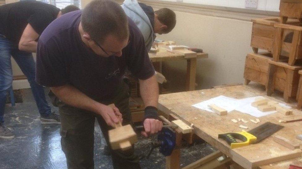 people working in workshop
