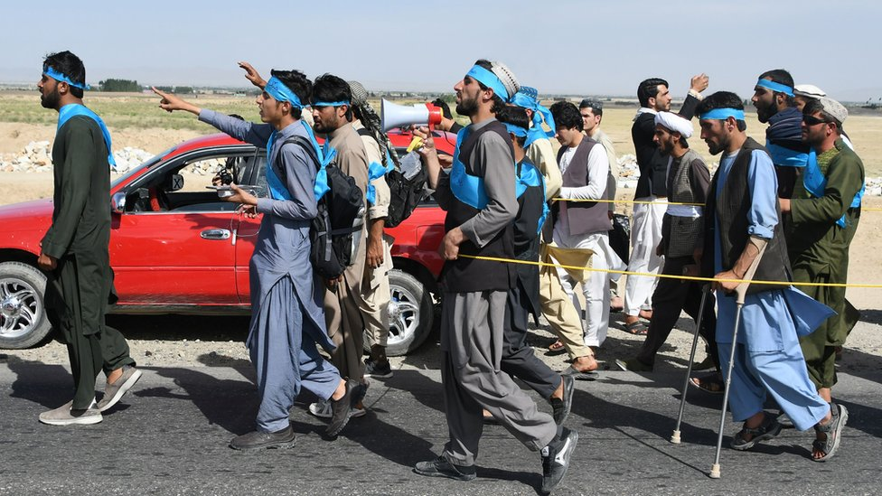 This picture taken on June 8, 2018 shows Afghan peace activists shouting slogans in demand to an end to the war