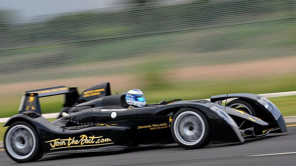 Twice Formula One world champion driver Mika Hakkinen of Finland drives a high performance two seater Johnnie Walker super car in Singapore on September 21, 2009