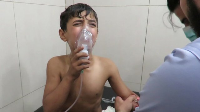 A boy is treated for breathing difficulties