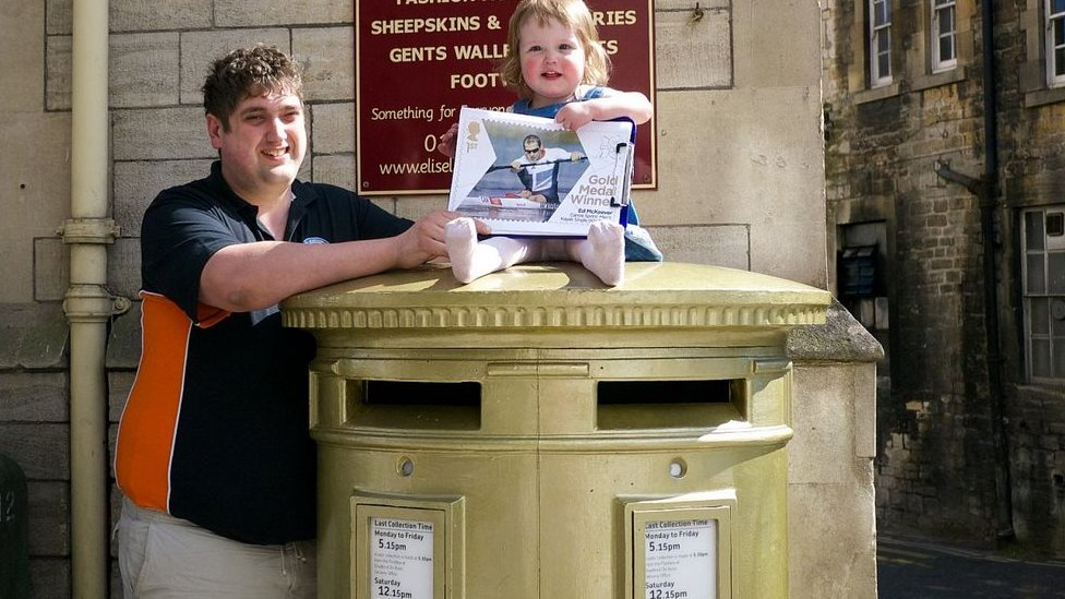 Michael and Jessica George at the gold postbox in Bradford on Avon for Ed McKeever