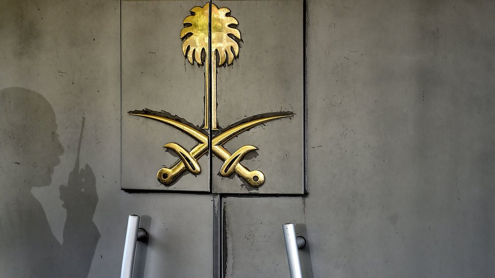The shadow of a security member of the consulate is seen on the doors of the Saudi Arabian consulate on 1 November 2018 in Istanbul